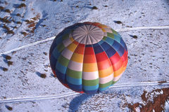 Hot Air Balloon Over Snow Stock Images