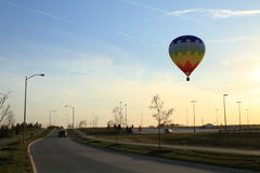 Hot Air Balloon over town Stock Images