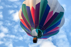 Hot Air Balloon Overhead. A hot air balloon floats overhead Stock Photo