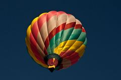 Hot air balloon passing overhead Royalty Free Stock Photo