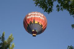 Hot Air Balloon with people in the clear blue sky Royalty Free Stock Images