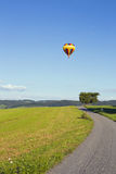 Hot air balloon. Photographed against the blue cloudless sky Stock Photography