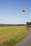 Hot air balloon. Photographed against the blue cloudless sky Royalty Free Stock Photos
