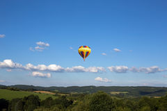 Hot air balloon. Photographed against the blue cloudless sky Stock Photo