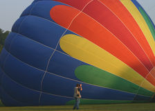 Hot Air Balloon Photographer. Shot of a photographer taking a picture of a hot air balloon Stock Photos