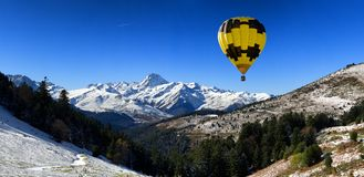 Hot air balloon with Pic du Midi de Bigorre  Pyrenees. Hot air balloon with mountains Pic du Midi de Bigorre  Pyrenees Royalty Free Stock Photography
