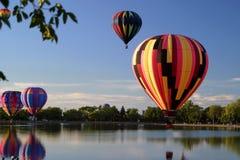 Hot air balloon pilot flight travel. Hot air ballooning landscape mountains Stock Photo