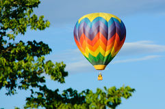 Hot air balloon in rainbow colors Stock Images