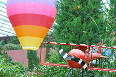 Hot air balloon and red plane Royalty Free Stock Images