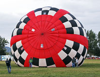 Hot air balloon red white black checkers Stock Photography