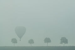 Hot Air Balloon reunion in the fog Stock Photo