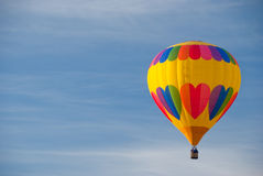 Hot air balloon ride. Hot air balloon and blue sky Royalty Free Stock Photos