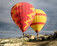 Hot air balloon ride with dark clouds - Cappadocia Royalty Free Stock Photos