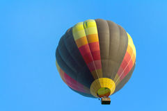 Hot Air balloon. A hot air balloon rides in the air Royalty Free Stock Images