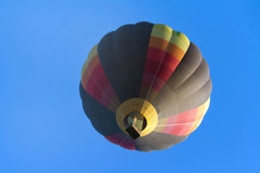Hot Air balloon. A hot air balloon rides in the air Stock Image