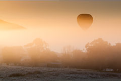 Hot Air Balloon Rises Thru The Mist Royalty Free Stock Image