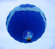 Hot Air Balloon Rising. Rising hot air balloon with flame stock images