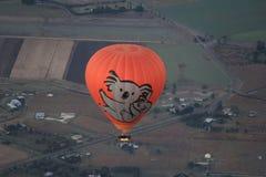 Hot Air Balloon rising high Stock Photo
