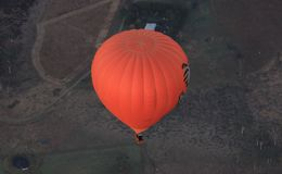 Hot Air Balloon rising high over landscape Stock Photography