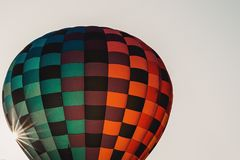 Hot Air Balloon Rising in Morning Sun Royalty Free Stock Photos
