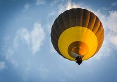 Hot air balloon rising. View from below Royalty Free Stock Image