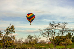 Hot Air Balloon in a Rural Landscape Royalty Free Stock Image