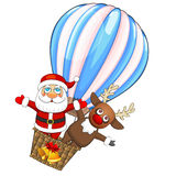 Hot air balloon with Santa Claus and deer Stock Images