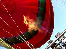 Hot air balloon with flaming burners stock images