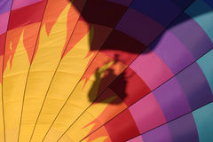 Hot air balloon shadow. The shadow of a hot air balloon and its crew are shown on another balloon at the September 2003 Atlantic International Balloon Fiesta Stock Images