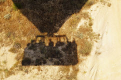 Hot air balloon shadow or dry arid earth Stock Photography
