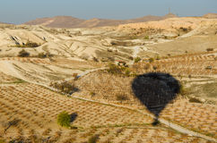 Hot Air Balloon shadow laying down on plant field, Cappadocia,  Royalty Free Stock Photos