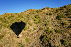 Hot Air Balloon Shadow in Rio Grande Gorge in Taos New Mexico. Set sail on a hot air balloon adventure with this shadow image in the Rio Grande Gorge in Taos New royalty free stock image