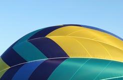 Hot Air Balloon. A side view of a colorful hot air balloon stock photos
