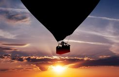 Balloon silhouette in the sunset Royalty Free Stock Photo