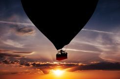 Balloon silhouette in the sunset Stock Image