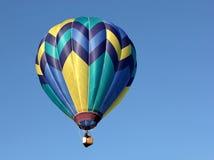Hot Air Balloon. A single hot air balloon in flight stock image