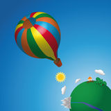 Hot air balloon in the sky. Flying off the balloon in the sky on a globe Royalty Free Stock Photography