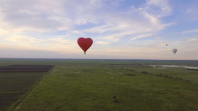 Hot air balloon in the sky over a field.Aerial view stock video footage
