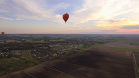 Hot air balloon in the sky over a field.Aerial view stock video