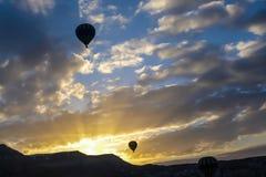 Hot air balloon on the sky at sunrise background , silhouette image. Hot air balloon on the sky at sunrise background in Turkey , silhouette image Stock Photo