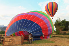 Hot air balloon start in vang vieng. Balloon over Song river in Vangvieng, Vang Vieng is a tourist attraction town in northern Laos Royalty Free Stock Photo