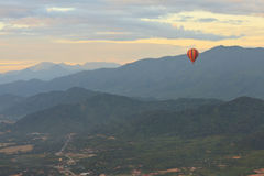 Hot air balloon start in vang vieng. Balloon over Song river in Vangvieng, Vang Vieng is a tourist attraction town in northern Laos Stock Photos