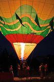 Hot air balloon starting to fly in evening sky Stock Photography