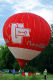 Hot air balloon starting to fly in evening sky Royalty Free Stock Images