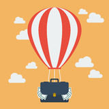 Hot air balloon with suitcase full of money Stock Photos