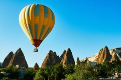 Hot air balloon in Mountains Cappadocia Turkey stock photo