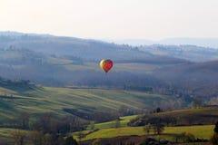 A hot air balloon at sunrise stock photos