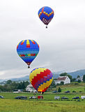 Hot air balloon three liftoff Royalty Free Stock Photography