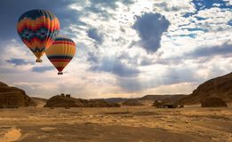 Hot Air Balloon travel over desert stock photo