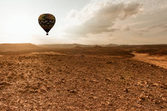 Hot Air Balloon travel over desert stock image